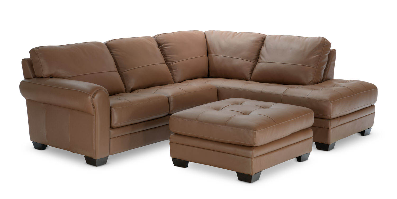 norman piece leather modular sectional with matching ottoman  -